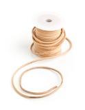 Corde de cuir de Brown sur la bobine en plastique Image libre de droits