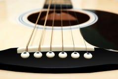 Corde della chitarra Fotografia Stock