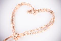 Corde orange dans la forme de coeur Photo stock