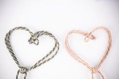 Corde orange et verte dans la forme de coeur Photographie stock libre de droits