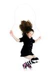 Corde à sauter sautante de petite fille Images libres de droits