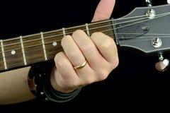 Corde sur la guitare Photographie stock