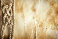 Corde sur le vieux fond de papier Image libre de droits