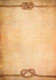 Corde sur le vieux fond de papier de parchemin Photos libres de droits