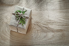 Corded handmade present box with thuya branch on wooden board Stock Photo
