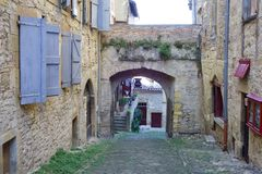Cordes-sur-Ciel. Quiet lane and courtyard between houses attached to the city wall royalty free stock photography
