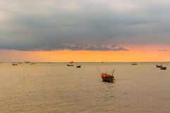 Cordia sebestena flowersSmall fishing boats on the sea during sunset and clouds. Stock Photos
