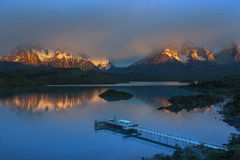 Cordillera del Paine - Torres del Paine - Patagonia - Chile. First light of dawn on the mist covered mountain peaks of Cordillera del Paine in Torres del Paine stock image