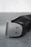 Cordless black electric razor. Electric razor  close up dark Royalty Free Stock Image