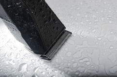 Cordless black electric razor close up. Electric razor with splashes of water drops isolated Royalty Free Stock Photography