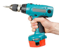 Cordless drill. Hand holding battery-powered electric drill with fastener on white background stock images