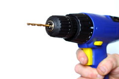 Cordless drill. Photograph of a person holding a cordless drill Stock Photography