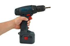 Cordless drill. A hand holding a cordless drill with a cross head driver tip stock images