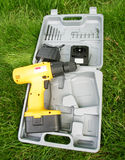 Cordless Drill. A cordless drill and with it's case and accessories Stock Image