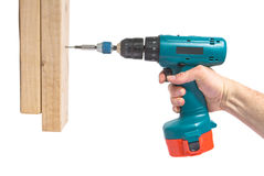 Cordless Drill. Handyman using cordless drill to drive a wood into 2x4s stock image