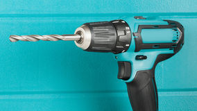 Cordless drill. On the background of the case closeup Stock Photography
