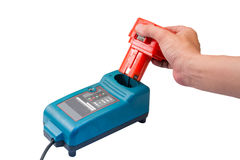 Cordless drill battery charger. Isolate Royalty Free Stock Photo