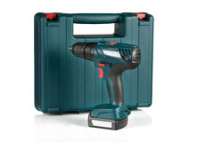 Cordless drill and case. On white background Stock Photos
