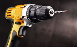 Cordless drill with drill bit working also as gun.  stock photography