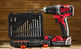 Free Cordless Drill Driver In Red With Rubberized Handle In Profile With Drill Bits Set Stock Photos - 148198093