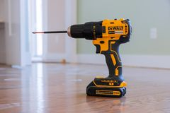 Free Cordless Drill Drivers DeWalt A Wooden Table For Home Improvements To A Kitchen Wall Stock Image - 165376541