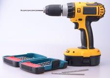Cordless Drill with masonry bits. A cordless drill with a variety of masonry bits Stock Photos