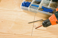 Cordless drill, screws and toolbox Stock Image