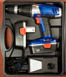 Cordless hammer drill kit in black case. Cordless hammer drill and spare rechargeable battery kit in black case Stock Images