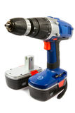 Cordless hammer drill and spare battery. Cordless hammer drill and spare rechargeable battery, isolated Stock Photography