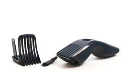 Cordless machine for a hairstyle on white royalty free stock photos
