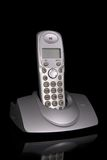 Cordless phone. In cradle on black background Royalty Free Stock Photos