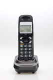 Cordless phone in cradle Royalty Free Stock Photos
