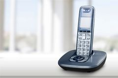 Cordless phone with cradle on white background. Phone cordless cradle clipping path white background object stock photos