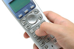 Cordless phone in hand Royalty Free Stock Photography