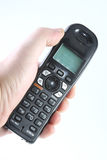 Cordless phone in hand Royalty Free Stock Image