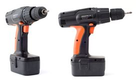 Cordless power drill. Isolated cordless power drill in two views Stock Images