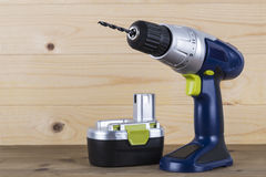 Cordless Power Drill and Battery Royalty Free Stock Photos