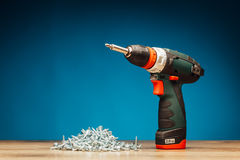 Cordless screwdriver and fasteners screws Stock Photography