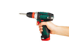 Cordless screwdriver in hand Stock Photography