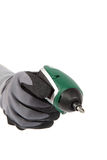 Cordless screwdriver in hand in a protective glove. Stock Photos