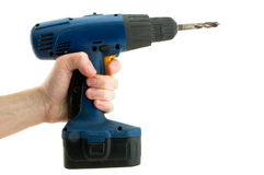 Cordless screwdriver in his hand Stock Images