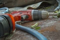 Cordless screwdriver on the roof royalty free stock images