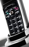 Cordless telephone. Closeup view of a cordless telephone in it's stand, focusing on the keypad royalty free stock images