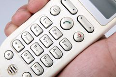 Cordless telephone. In the hand Stock Image