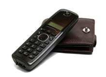 Cordless telephone and wallet Royalty Free Stock Photography