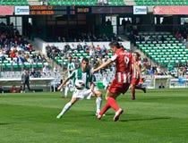 CORDOBA, ИСПАНИЯ - 17-ОЕ МАРТА: Карл Dias Oliveira r (9) в действии во время лиги Cordoba спички (w) против Альмерии (r) (4-1) на  Стоковая Фотография