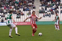 CORDOBA, ИСПАНИЯ - 17-ОЕ МАРТА: Рубен Suarez r (10) в действии во время лиги Cordoba спички (w) против Альмерии (r) (4-1) Стоковое фото RF