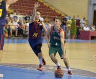 CORDOBA, ИСПАНИЯ - 14-ОЕ СЕНТЯБРЯ:  LEX URTASUN g à (4) в действии во время FC Barcelona спички (b) против CB Севильи (g) (91-85 Стоковое Изображение