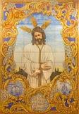 Cordoba - керамический крыть черепицей, Иисус в скреплении на фасаде дома на квадрате Compas de Сан-Франциско a Линарес (1995) Стоковые Изображения RF