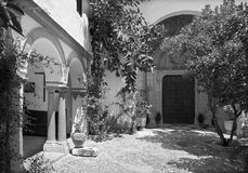 Cordoba - The atrium and late gothic potal on church of monastery Convento Santa Marta. Stock Image